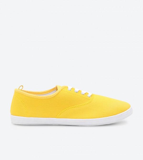 سنيكرز بلون أصفر