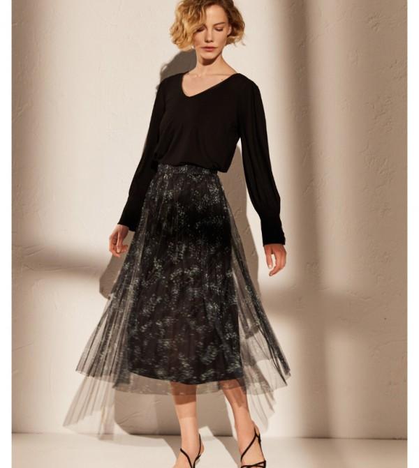 تنورة جيرسي - مطبوعة باللون الأسود