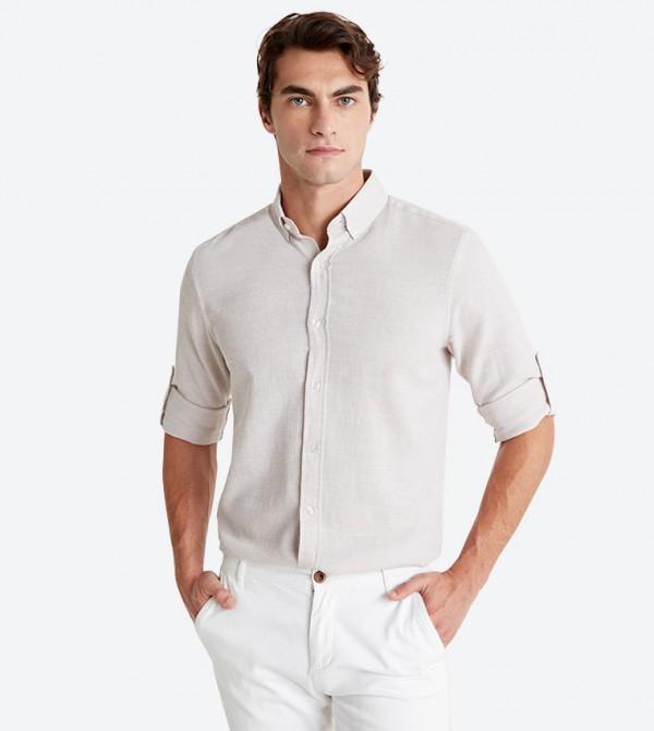 قميص بأكمام طويلة لون بيج