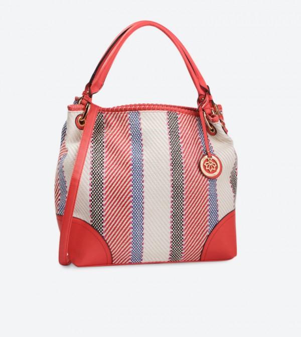 حقيبة يد بلون أحمر
