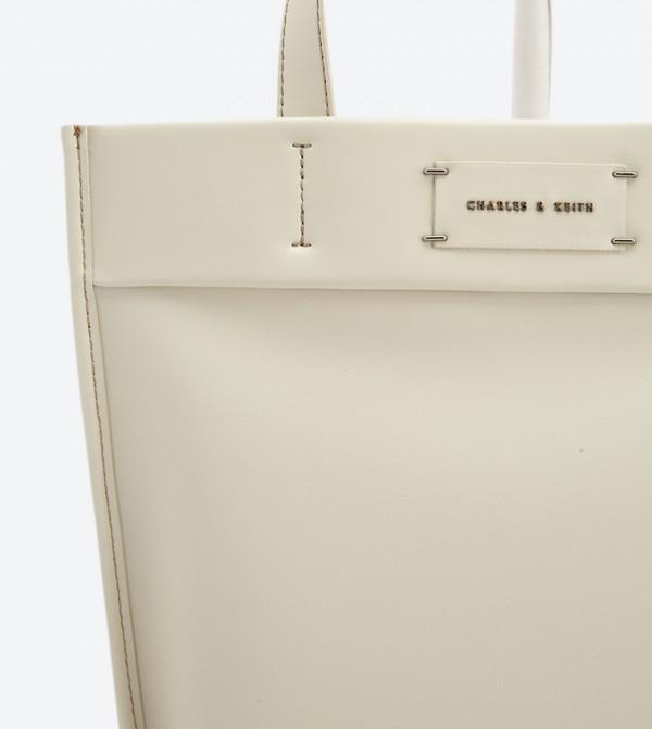 fb04845b89628 حقيبة يد بلون أوف وايت