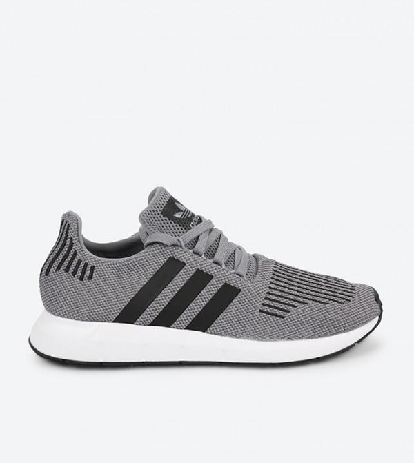 c14159a4d870c Home  Swift Run Sneakers - Grey. CQ2115-GREY