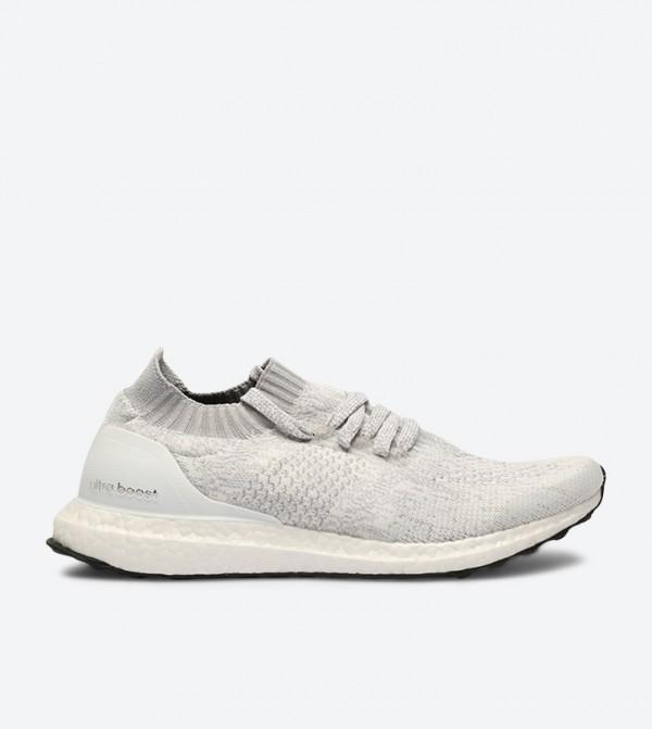 2158cbf99cfde Home  Ultraboost Uncaged Sneakers - White DA9157. DA9157-WHITE-BLACK